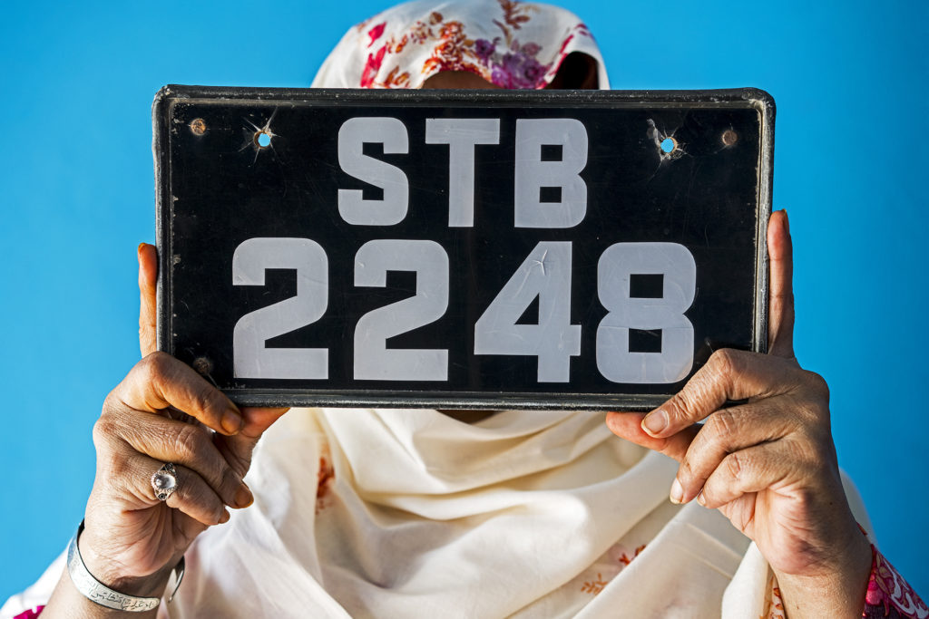 6-SH-Aunty Chubo Holding Rear License Plate