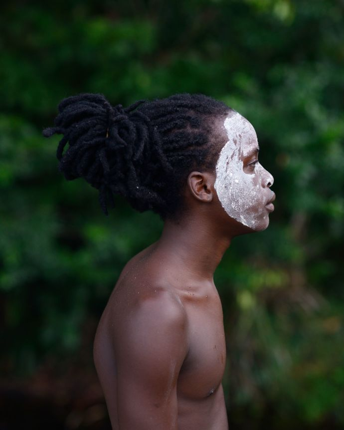Christophe with «pemba» or the white clay on his face, Charvein, French Guiana.