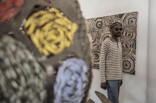 FundaLehlohonolo Mkhasibe stands by one of his sculptures at FUNDA art foundation in Soweto, South Africa