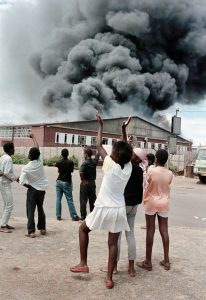 GraemeWilliamsBophutatswana Homeland, Garankuwa. 1990. A factory is set alight during demonstrations against the Bophutatswana government in Garankuwa.